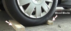 Lifting the car- Secure your car with wood blocks